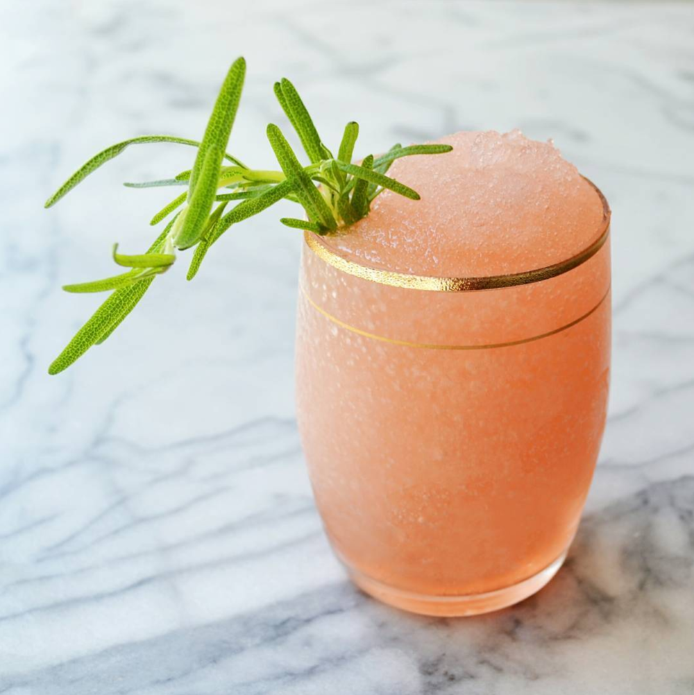 Frosémary 1 bottle of rosé Ice 3 oz strawberry simple syrup   3 oz freshly-squeezed lemon juice Fresh rosemary garnish