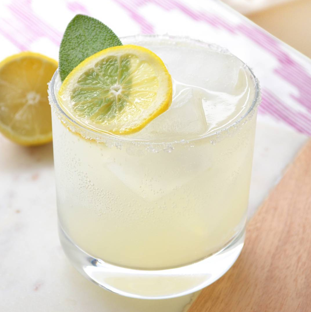 Adults' Only Lemonade 1.5 oz vodka 1 oz sweet and sour 1/2 lemon, freshly-squeezed ½ oz maple simple syrup Lemon sparkling water Sugar for rim Lemon slice and sage leaf for garnish