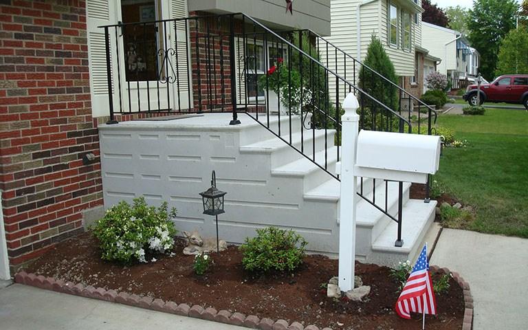 precast-steps-iron-railing.jpg