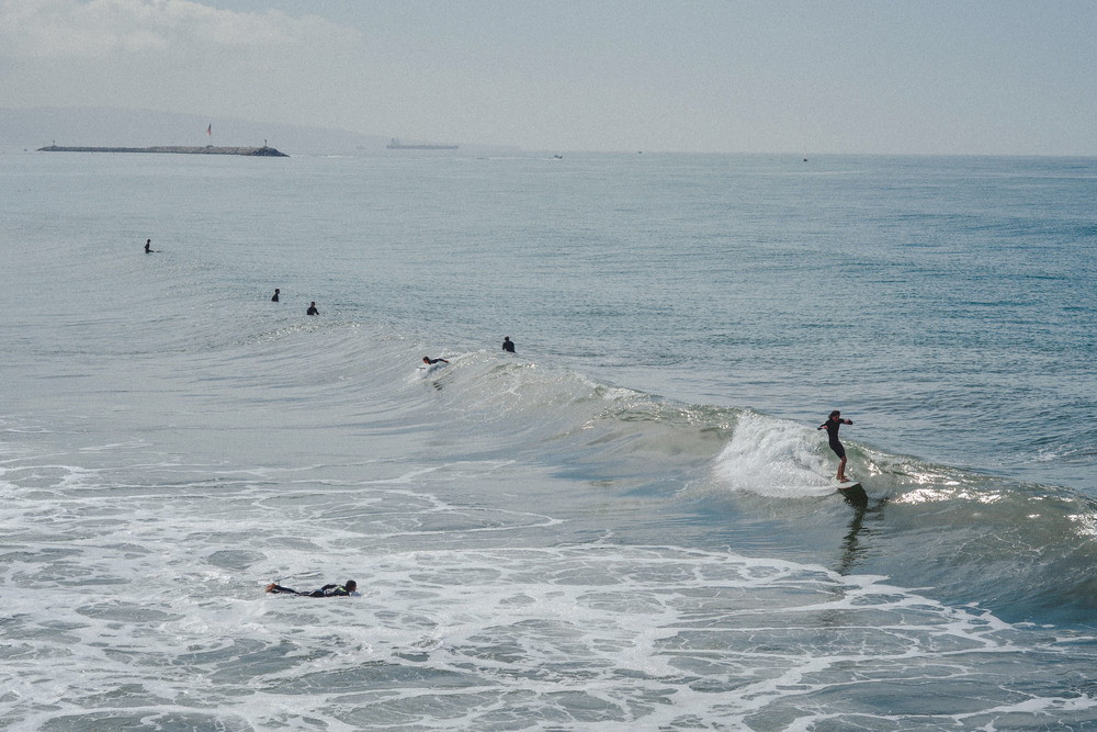 9 surfers on the surf.jpg