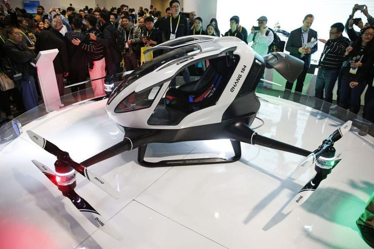 The EHang 184 autonomous aerial vehicle is unveiled at the EHang booth at CES International in Las Vegas. The drone is large enough to fit a human passenger.(AP Photo/John Locher)