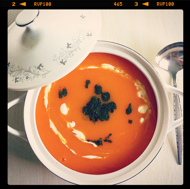 Sweet potato-carrot soup with cilantro pesto and yogurt cream.
