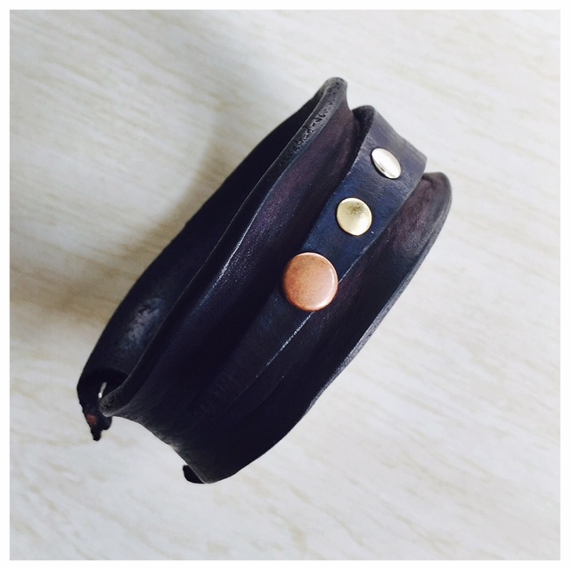 Secured, navy-dyed leather bangle with assorted rivets.  Cause, I love rivets!
