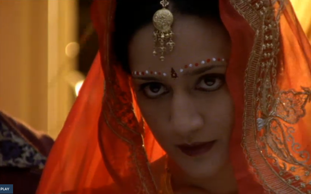 Archie Panjabi playing the role of Alsana Begum in the 2002 BBC miniseries adaptation of  White Teeth .