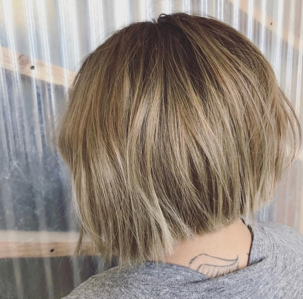 Texturized bob with blunt ends hair cut.