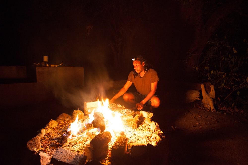 Dinner on the fire. Farayi preparing a braai which is traditional South African barbecue. Photo ©Lauri Soini