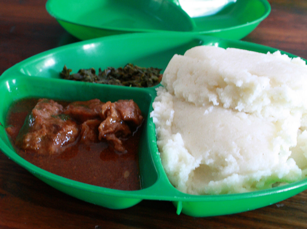 Very common basic lunch in Sambia: nshima, beef stew and spinach.