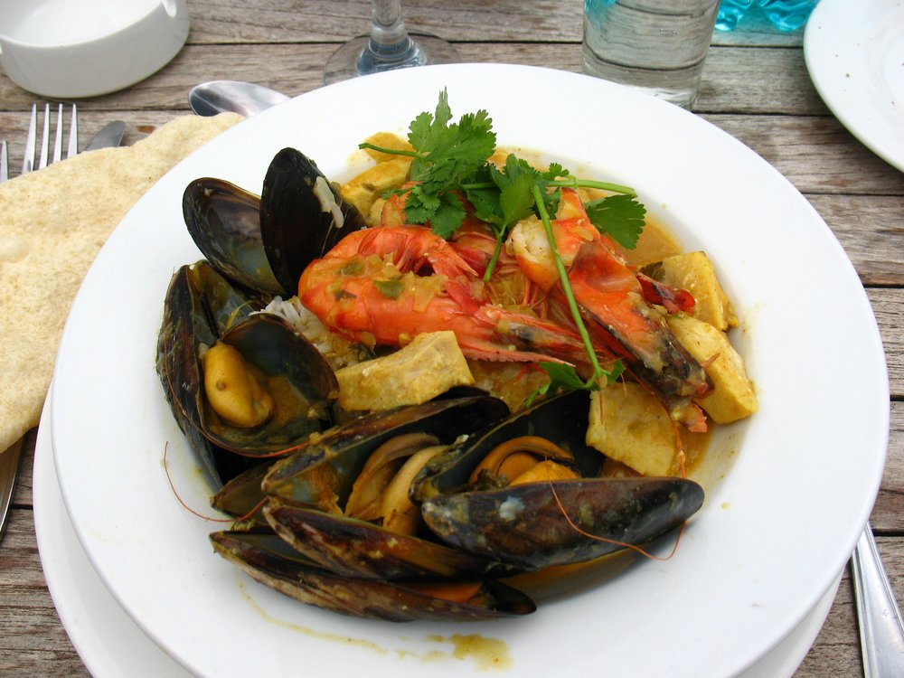 Cape Malay seafood curry from South Africa including black mussels, fish, and shrimp. Photo by:  Vilseskogen/Flickr