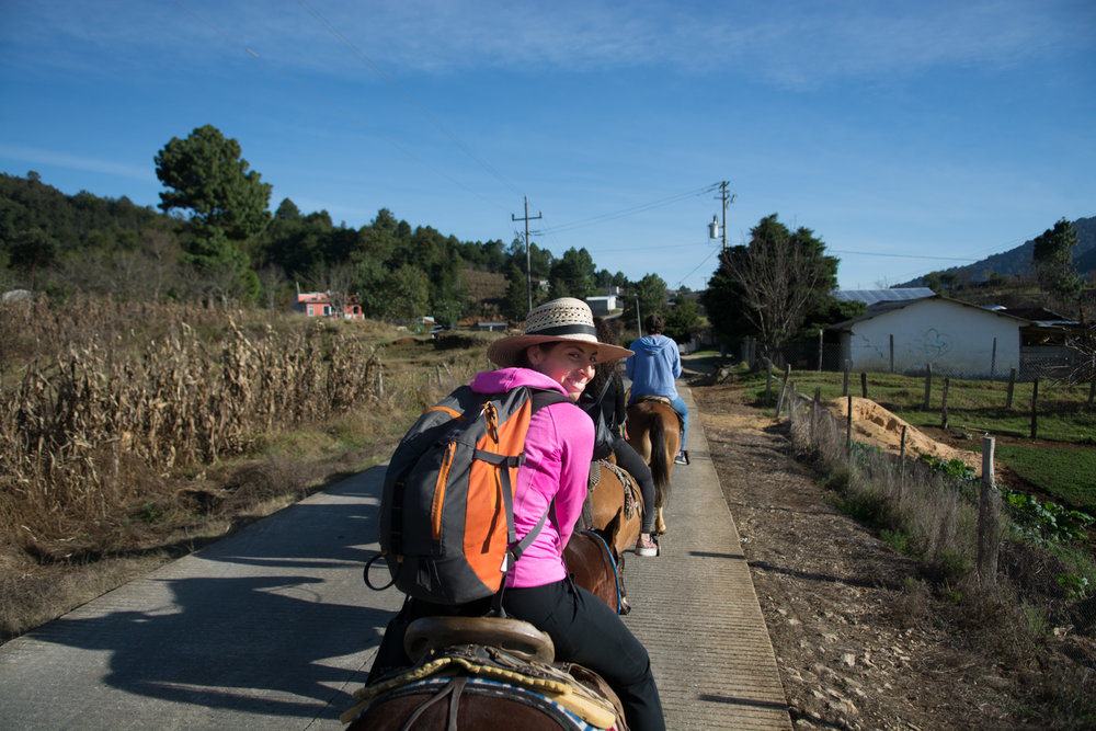 A horse ride through the countryside of Chiapas to the no doubt most crazy church we've ever seen.