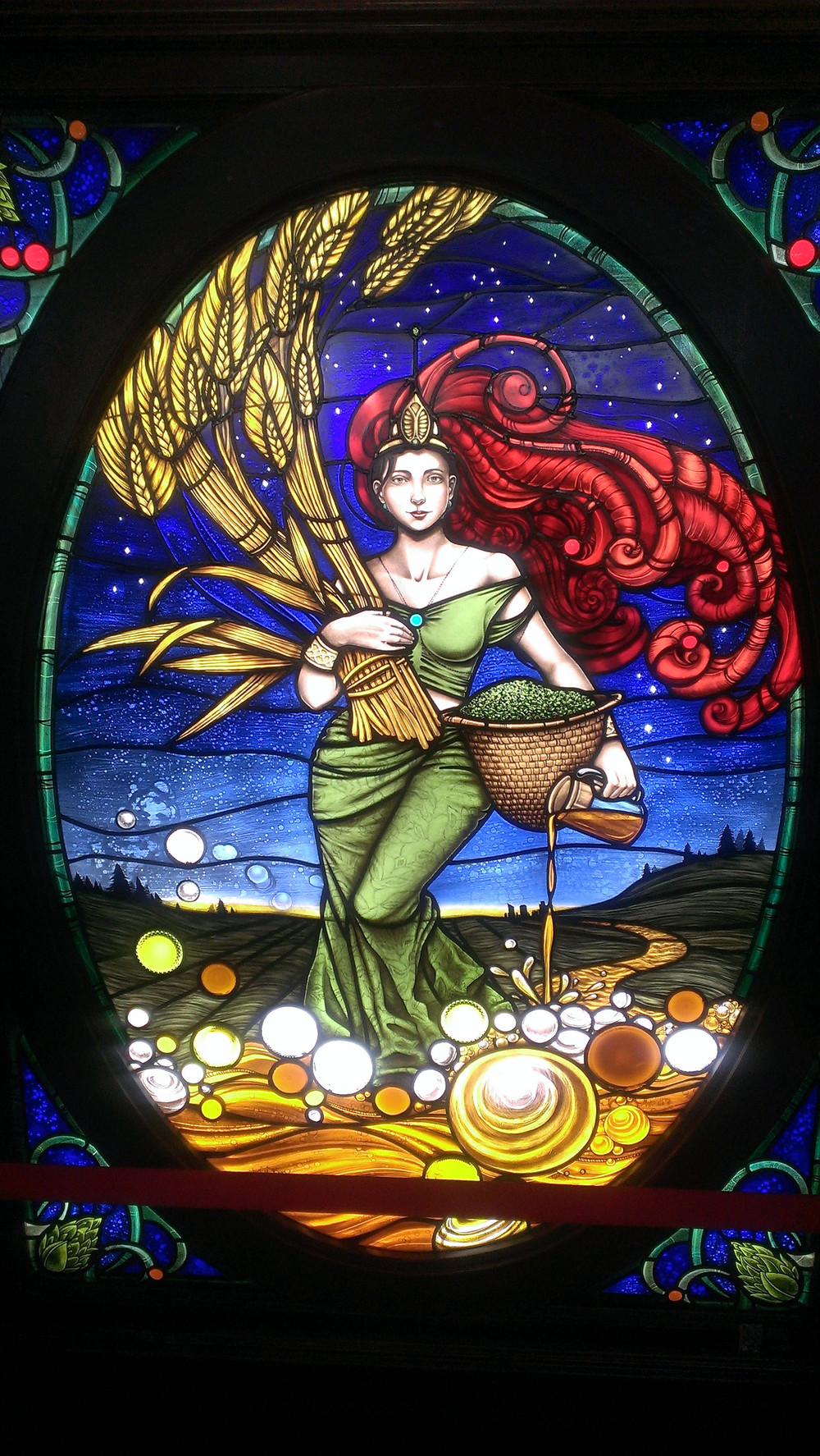 A depiction of the goddess Ninkasi in stained glass at Founders Brewing. Source: Vedo