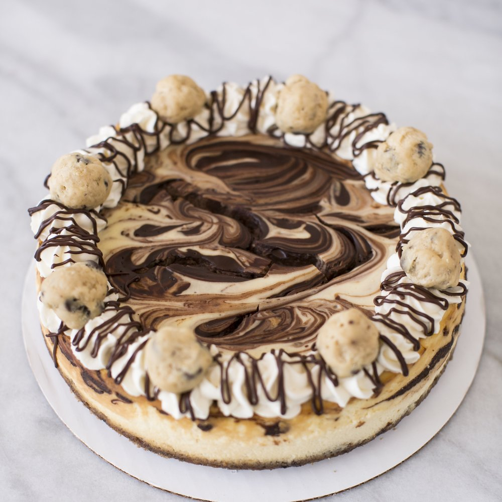 Cookie Dough  Marble cheesecake with edible cookie dough garnish and a chocolate chip cookie base.  $47
