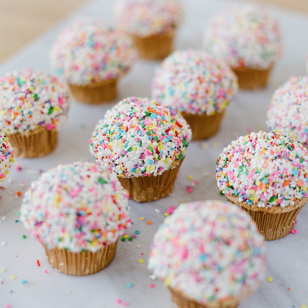 Very Vanilla   Vanilla cake and buttercream. Dipped in sprinkles.   $48