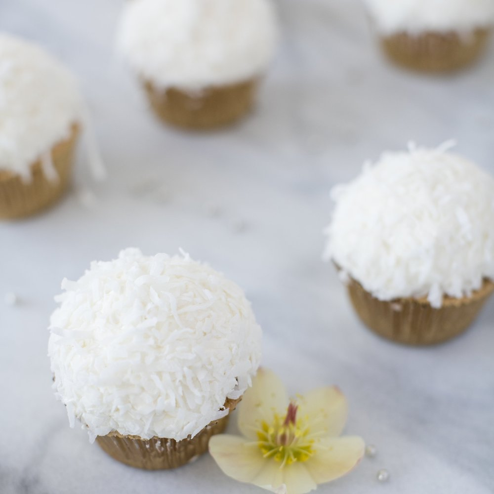 Coconut Cream Cupcakes  Vanilla Cake, Rounded Coconut Buttercream, Dunked in coconut shreds  $48