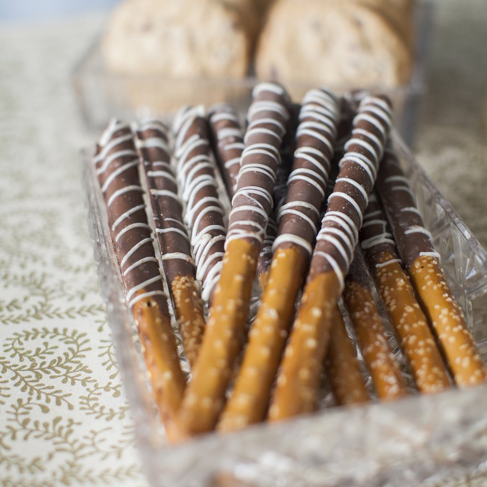 Sweet & Salty Pretzel Rods   Chocolate and White Chocolate dipped pretzels, multiple flavors.   $23 dozen