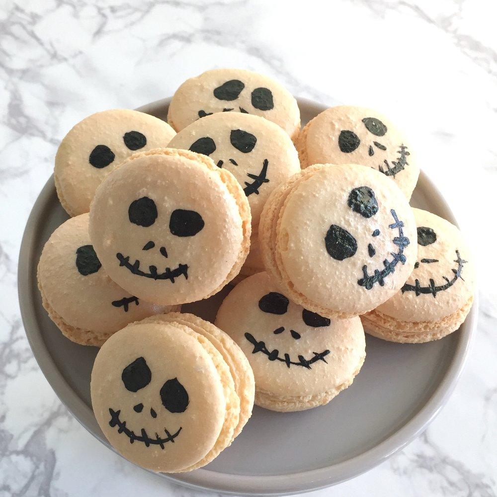 Skellington Macarons  Vanilla French Macarons ready for a spooky time!   $32 dozen