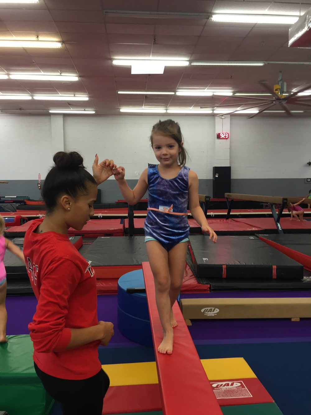 Ms. Kayleen helping a Firecracker across beam