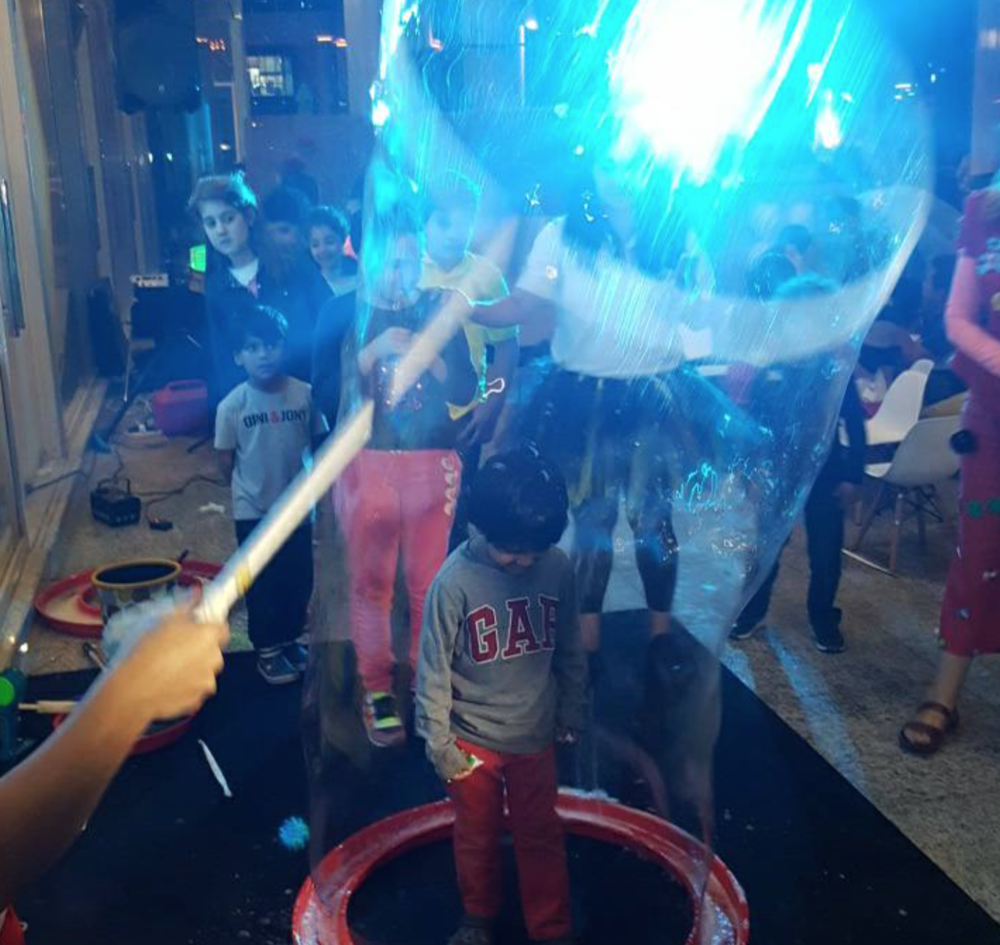 My youngest- Lil M, enjoying the Giant bubbles at the inaugural of 'The Beehive', his brother Nicky is looking on with keen eyes!