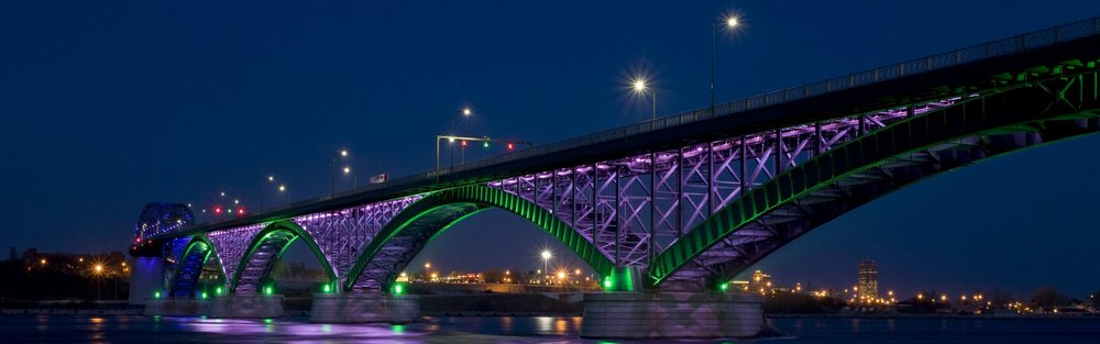 The Peace Bridge connects the city of Buffalo to the beautiful and friendly  Town of Fort Erie . Check the  Peace Bridge Authority 's website for  wait times  and  ID requirements .