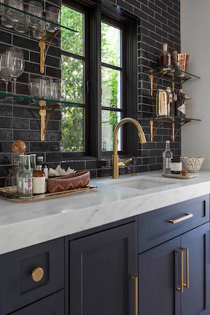 Reverse a color scheme by using black tiled wall backsplash with the light marble countertops. Another beautiful way to demonstrate how opposites attract!