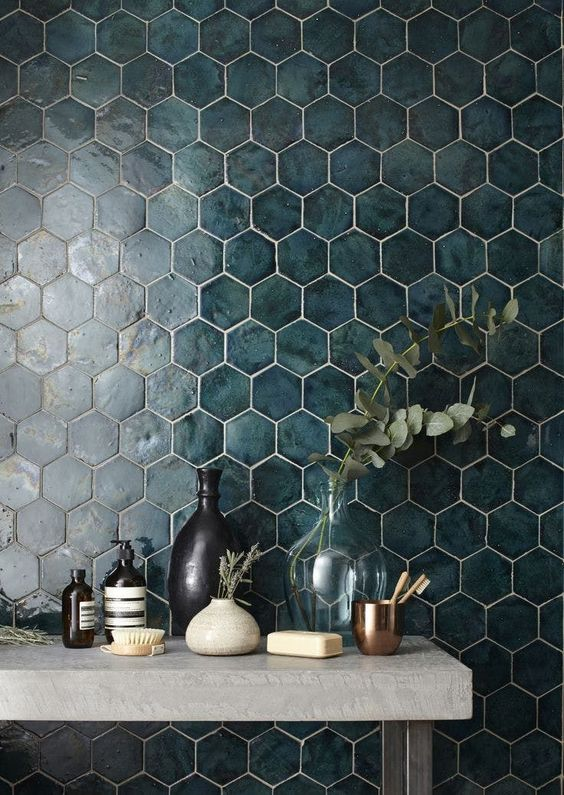 This beautiful hexagonal tile is an eye-catching shape in layers of deep and serene blue. It would work wonderfully as a backsplash to walnut kitchen cabinets or hold it's own on an accent wall.