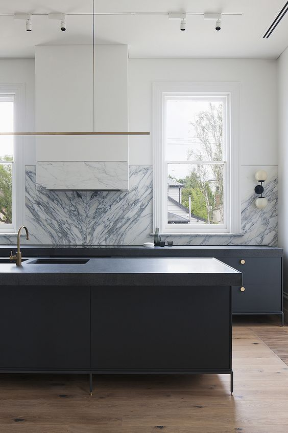 Marble has made a strong come-back in the design industry recently for a good reason-it captures the essence of upscale modern with it's clean edges and luscious vein designs. We love this marble backsplash because the material is opulent but also comfortable-it would provide the perfect backdrop to a fancy dinner party, but also an afternoon of cooking with the family.
