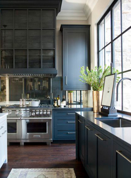 The antiqued mirror of this backsplash is a timeless style that is simple and easy to clean. It also has an added benefit of a reflection, which tricks the eye into adding depth to the space.
