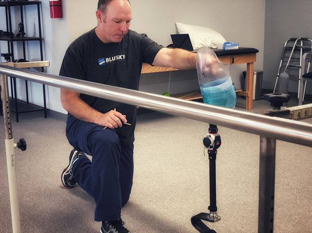 Aaron, one of our prosthetist at Blue Sky, checks alignment for our patient. Alignment contributes to a better walk and a more comfortable fit while wearing the prosthesis.  You can say, he is very detailed orientated - a huge benefit for our patients. • • • • #blueskysthelimit #blueskyprosthetics #WeLoveOurPatients #theselegsweremadeforwalking #walkon #walkstrong #prostheticleg #austin #atx #comfortablefit #checkingalignment #gaittraining #CPO #adaptivelife