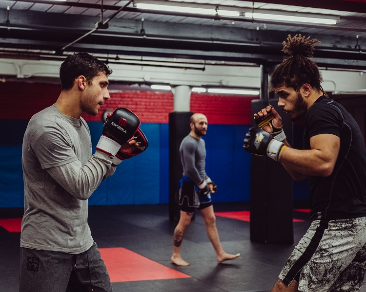 John Douma squares off with training partner Dion Rubio while Dan Cormier waits for his turn. Look for Dan and Dion at the next Cage Titans event!