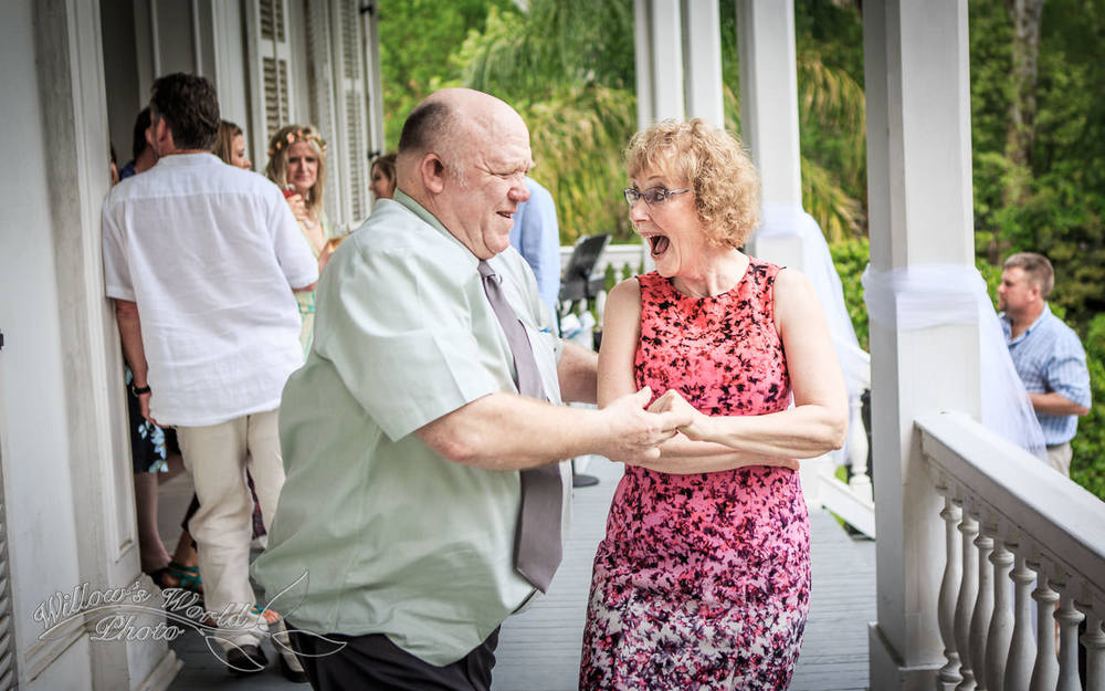 The parents of the bride go for a (literal) spin on the porch of a lovely Garden District home...