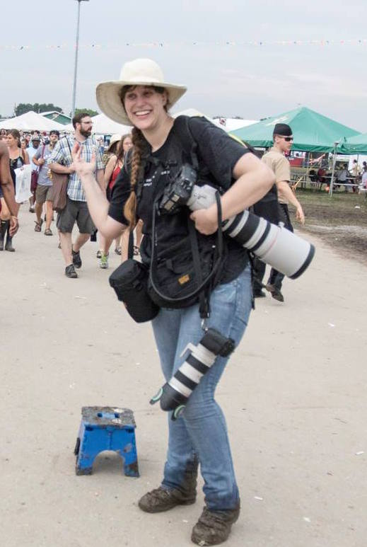 Also, good gear is really, really heavy!  (This is me shooting Jazz Fest, but the point stands...)