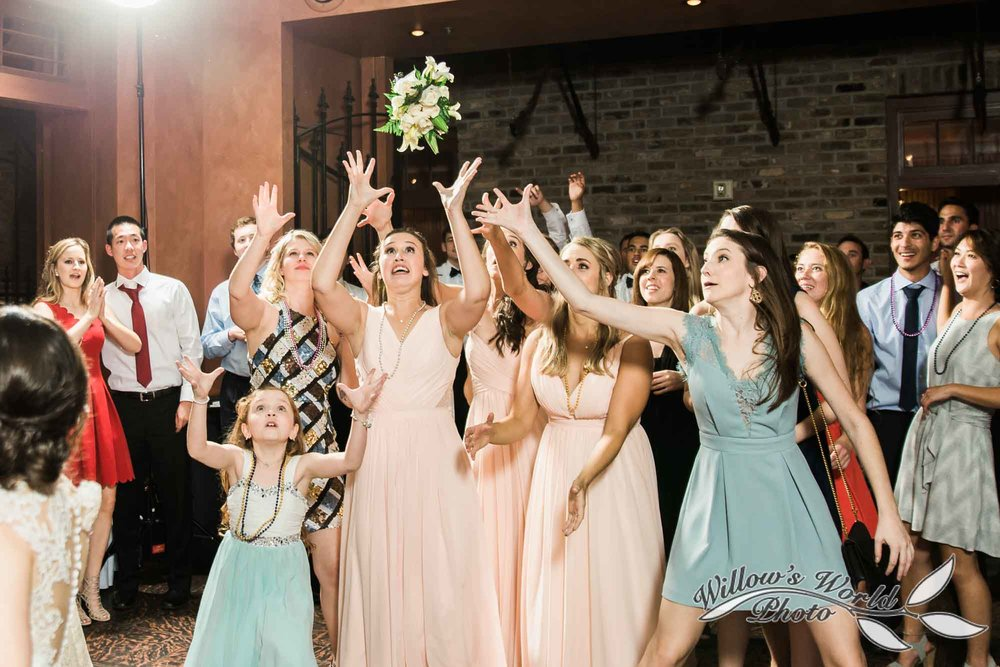 New-Orleans-Wedding-Bouquet-Toss-Willows-World-Photo-Pat-Os-On-the-River.jpg