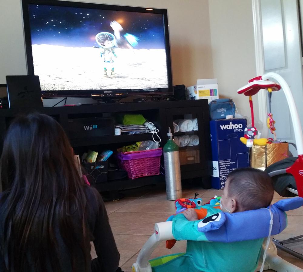 Progeny #1 & Progeny #2 watching TV together.