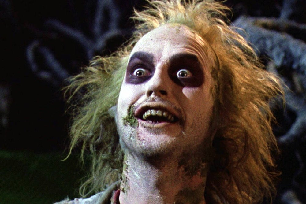 That face when you find out someone brought donuts to work. Also, fun fact: Beetlejuice was technically a poltergeist—and an asshole.