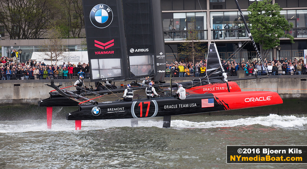 ORACLE Team USA gets towed past the crowds at North Cove Marina.
