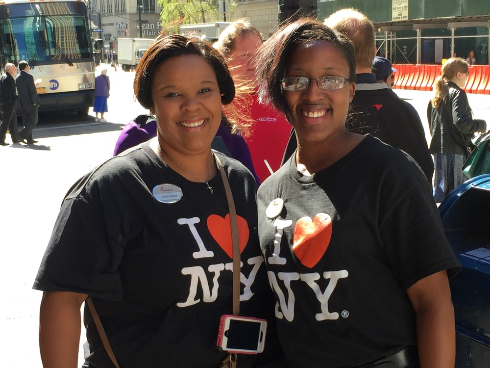 The customer service is still top notch at the NYC location of Chick-Fil-A.  Two employees are all smiles after come off break and returning to work.