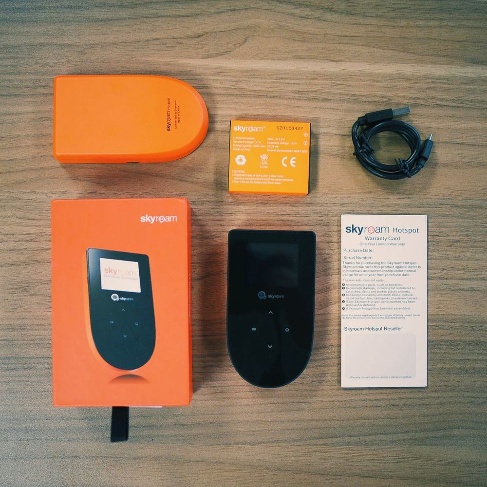 Included in the box:  Skyroam Hotspot, battery, USB charger, and instruction manual
