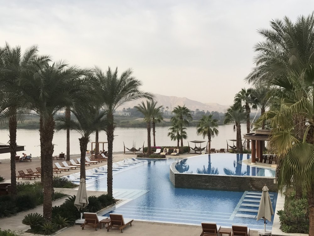 The pool area of the Hilton Luxor Resort and Spa is right next to the Nile River, with a view of the West Bank.
