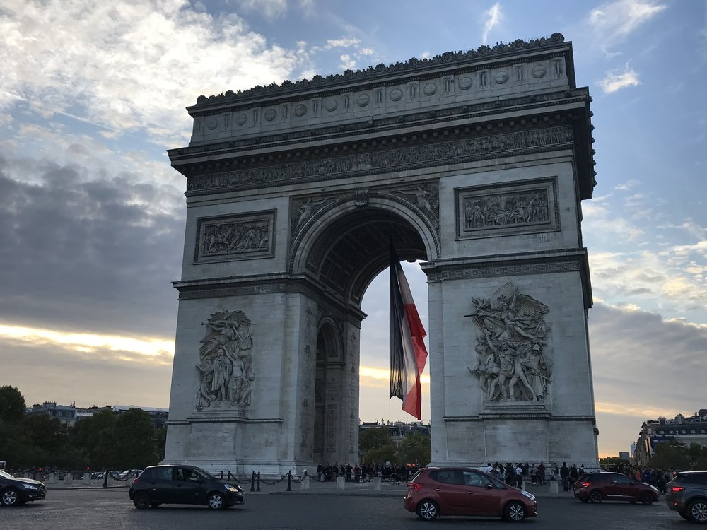 Arc de Triomphe as the sun was about to set. You have the option of climbing to the top of it and seeing an awesome view of Paris.