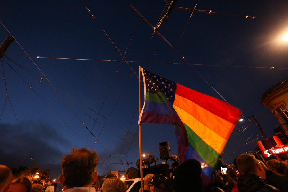 Hundreds gather during a vigil in Harvey Milk Plaza to remember the victims of the Orlando shooting.