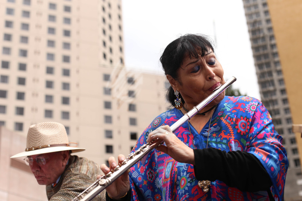 Oakland-born flautist Elena Durán serenading the crowd at the dedication ceremony for The Mexican Museum in San Francisco, California. Tuesday, July 19, 2016. Jessica Webb