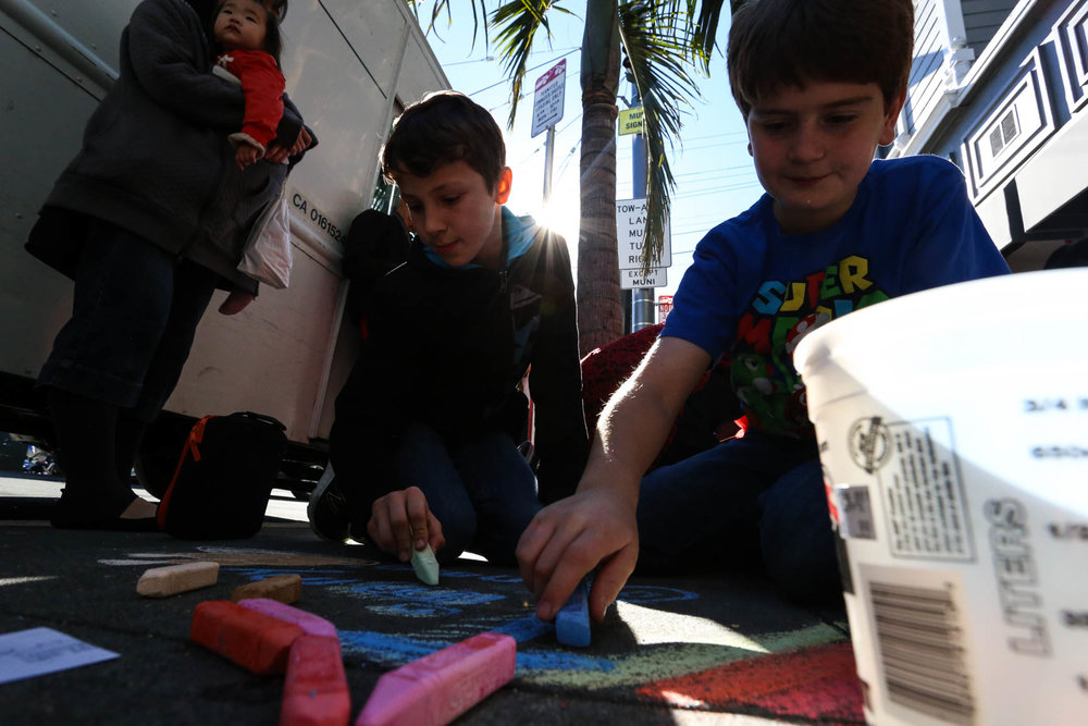 Luca Nastri-Case (10) & Wyatt Shaffer (10) students at the Harvey Milk Civil Rights Academy, INSCRIBE the names of the men and women who died of AIDS. Thursday, December 1, 2016, San Francisco, California (Jessica Webb).