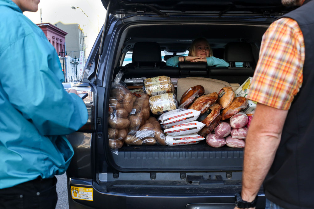 Curbside volunteers collect turkeys and other food donations for the Thanksgiving Day meals that will serve the homeless Mid-Market community, San Francisco, California, Wednesday, November 23, 2016 (Jessica Webb)