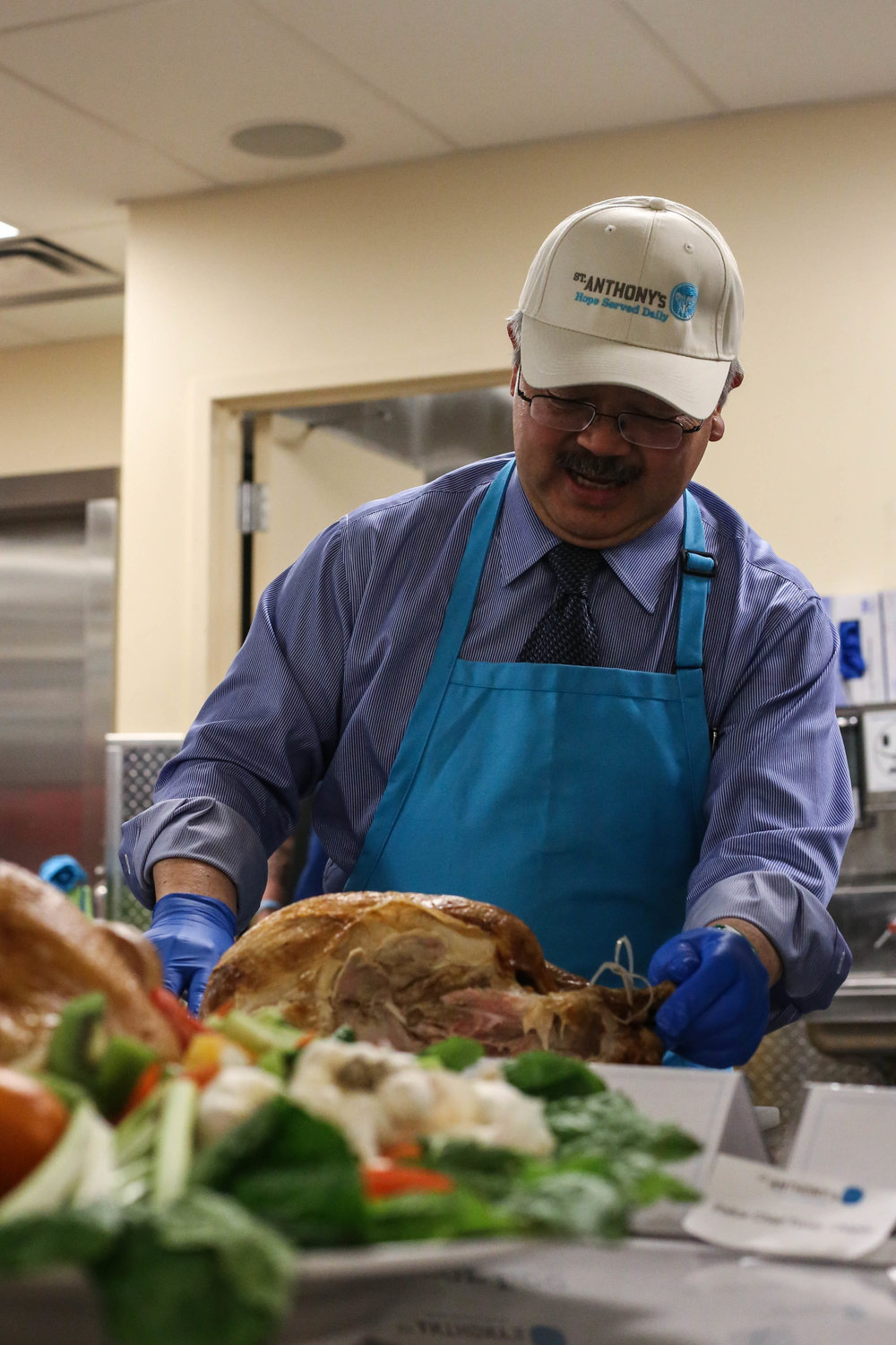Mayor Lee is among the many volunteers that came out on Wednesday, November 23, 2016 to help St. Anthony's chefs put the finishing touches on over 3,500 Thanksgiving Day meals that will serve the homeless Mid-Market community, San Francisco, California, (Jessica Webb)