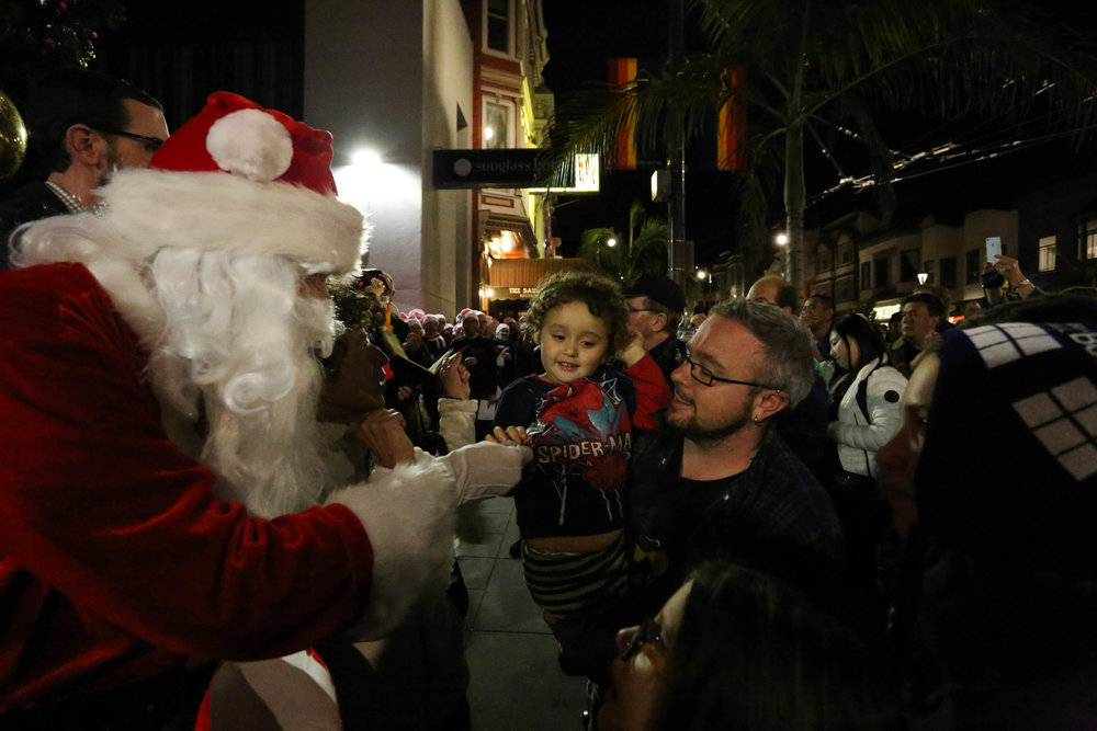 Santa made an appearance at the Castro tree lighting and brought candy for all the children in the crowd. Monday, November 28, 2016, San Francisco, California (Jessica Webb)