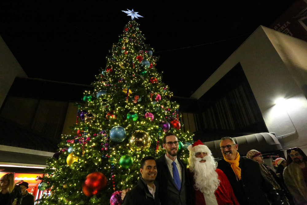Scott Wiener, Santa and Daniel Bergerac at the Castro tree lighting on Monday, November 28, 2016. San Francisco, California (Jessica Webb)