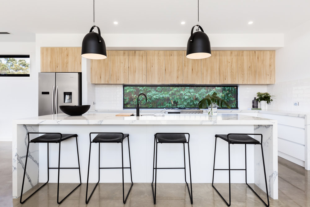 luxury kitchen with marble island.jpeg