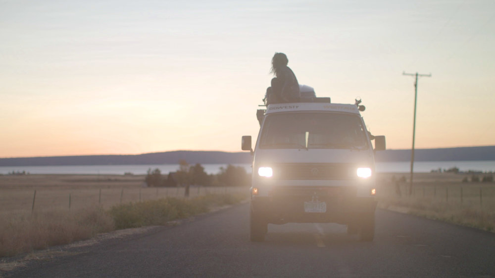 Emily King sits on top of her van watching the sunset. This was taken on the documentary trail in Northern California while filming  @wheresmyofficenow