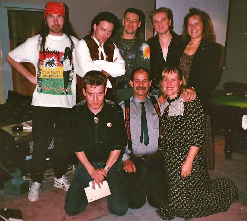 John Smith and his family with U2 in the 90s