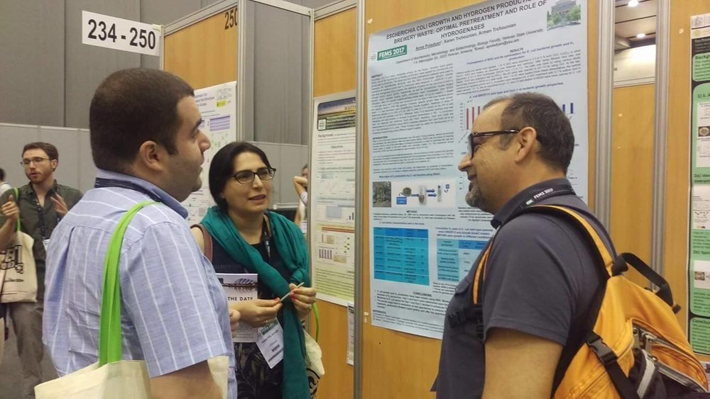 7. PI  Anna Poladyan with her colleagues discussing her abstract presented during the conference.jpg