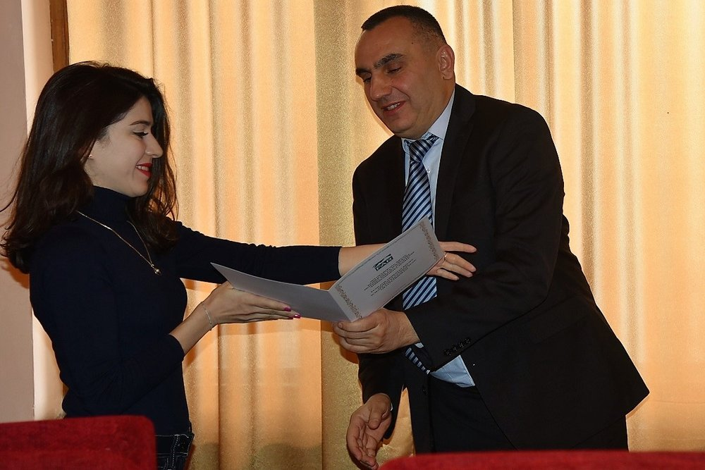11 Bagrat Sargsyan giving winner certificates to  Principle Investigators.JPG